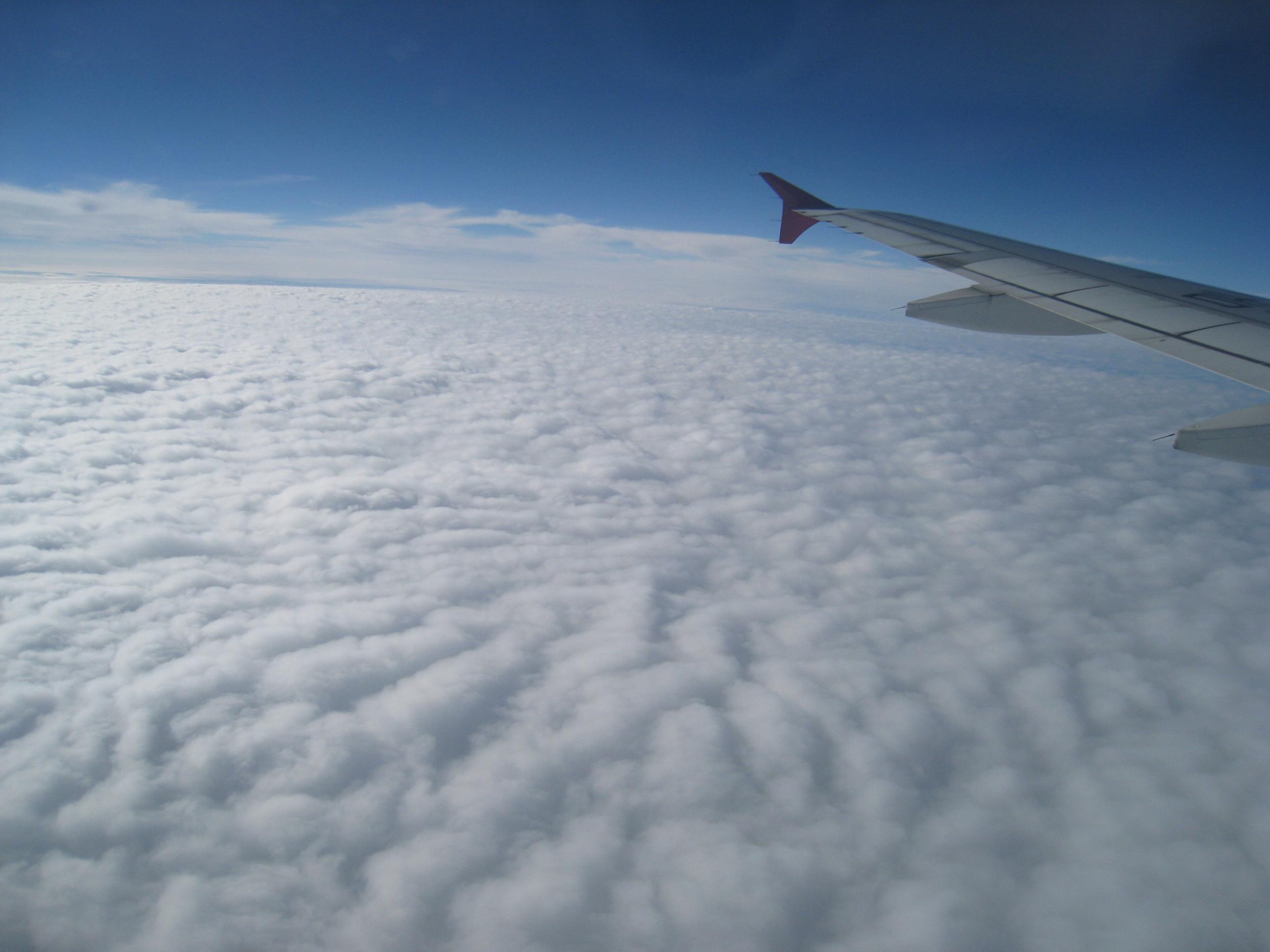 旅行心情记录:飞机上的云海